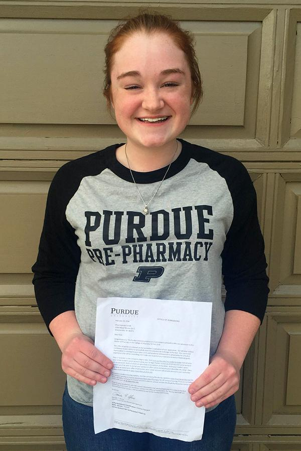 Elise Smith (12) shows off her acceptance letter to Purdue University. Smith plans to go into pharmacy when she graduates college.