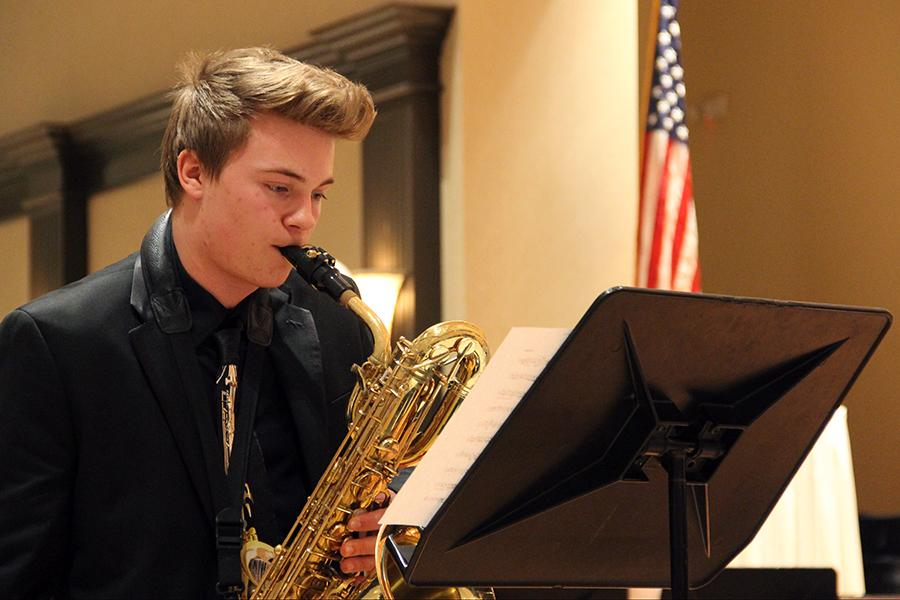 Jazz+II+member+Brice+Doescher+%2810%29+reads+his+music+while+playing+with+fellow+musicians.+The+saxophone+quartet+received+a+Gold+at+ISSMA+State.
