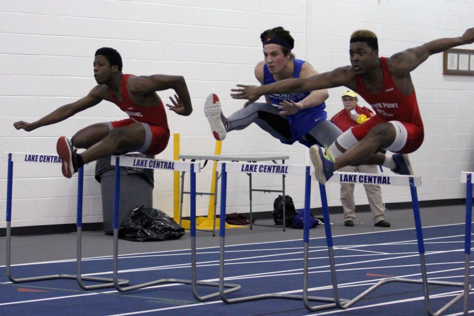 Nicholas+Lucas+%2811%29+launches+over+the+hurdles.+The+track+meet+was+against+Crown+Point.