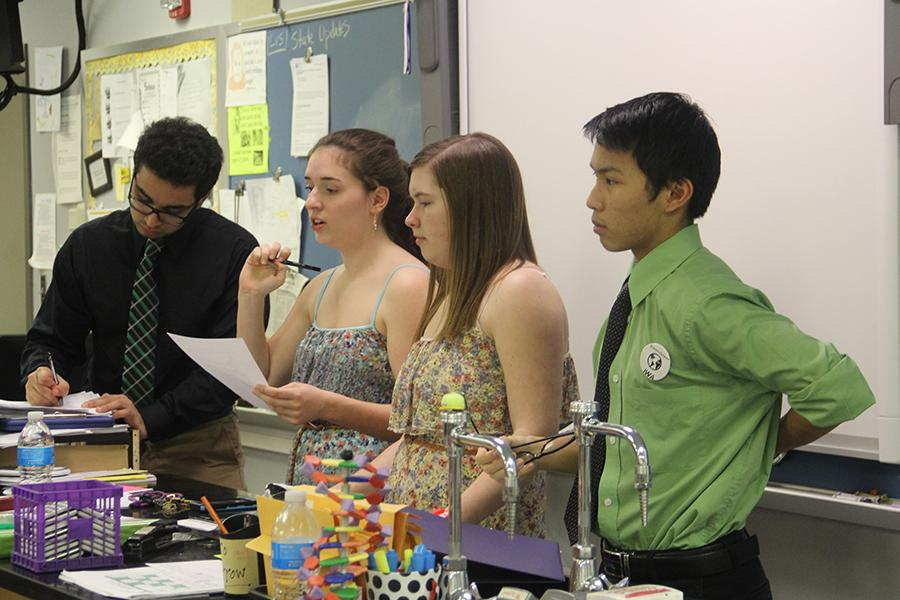 Jay+Chopra+%2812%29%2C+Samantha+McCuaig+%2812%29%2C+Madelyn+Ackerman+%2812%29+and+Matthew+Tao+%2812%29+prepare+to+start+the+Science+Olympiad+meeting.+This+was+their+final+meeting+before+State.+%0D%0A