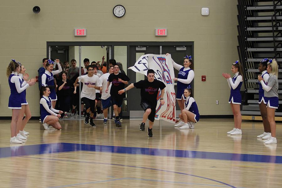 The West Lake All-Stars run out onto the field through a banner made by members of Best Buddies. The team celebrated Best Buddies Night during the game.