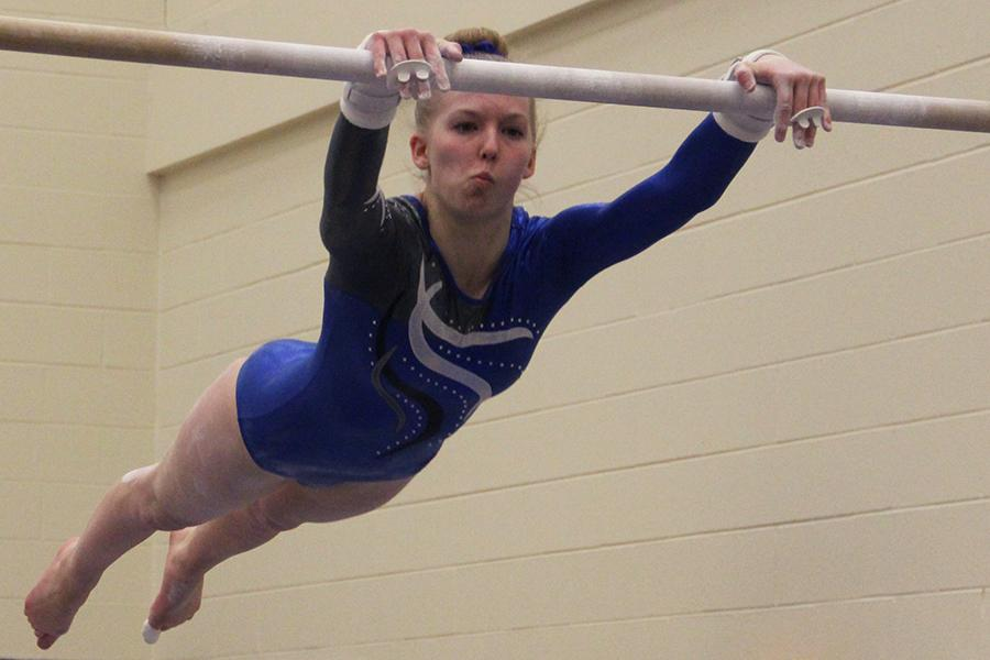 Madison+O%E2%80%99Drobinak+%2810%29+jumps+from+low+to+high+bar+during+the+gymnastics+team%E2%80%99s+meet+at+Hobart.+The+Indians+beat+the+Brickies.+