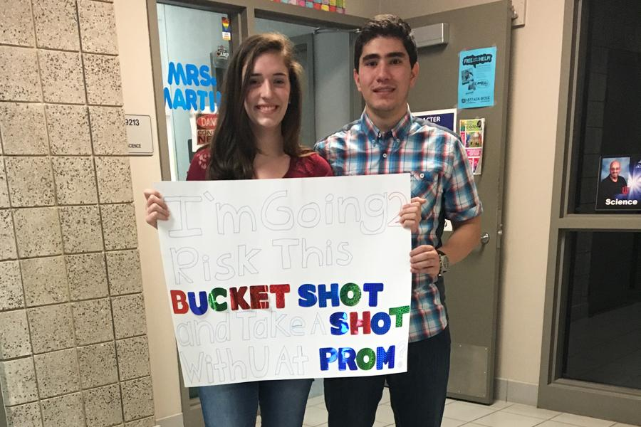Mohammed+Hijaz+%2811%29+and+Samantha+McCuaig+%2811%29+stand+behind+the+sign+Hijaz+made+to+ask+McCuaig+to+Prom.+Hijaz+had+shot+ping+pong+balls+labeled%2C+%E2%80%9CProm%3F%E2%80%9D+to+her+using+air+trajectory.+%0D%0APhoto+submitted+by+Mohammed+Hijaz+%2811%29
