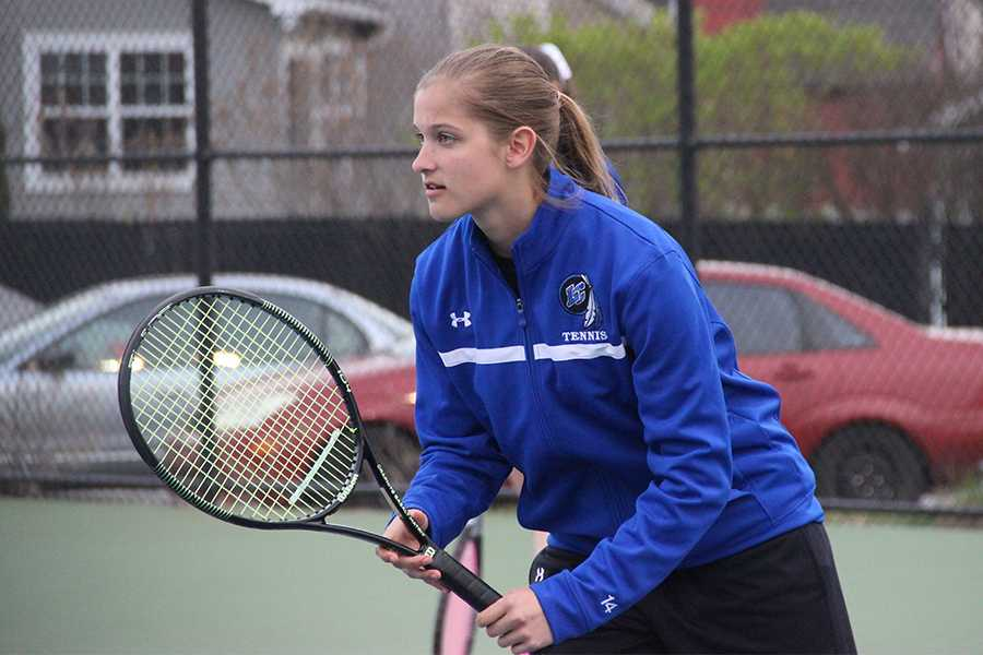 Sydney Batinick (10) prepares for her opponent's serve. Batinick played doubles against Whiting.