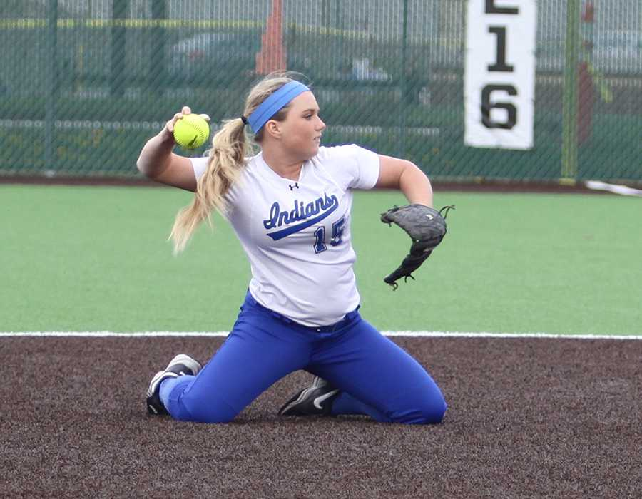 Paige Carter (12) makes a diving stop at second base. Carter will continue her career in softball playing at Western Kentucky University in the fall.
