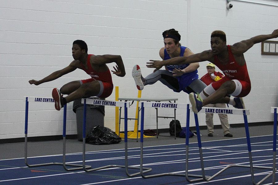 Nicholas+Lucas+%2811%29+hurdles+during+the+indoor+boys+track+and+field+meet+against+Crown+Point.+The+boys+continue+their+season+this+year+in+hopes+for+good+weather+for+the+outdoor+season.