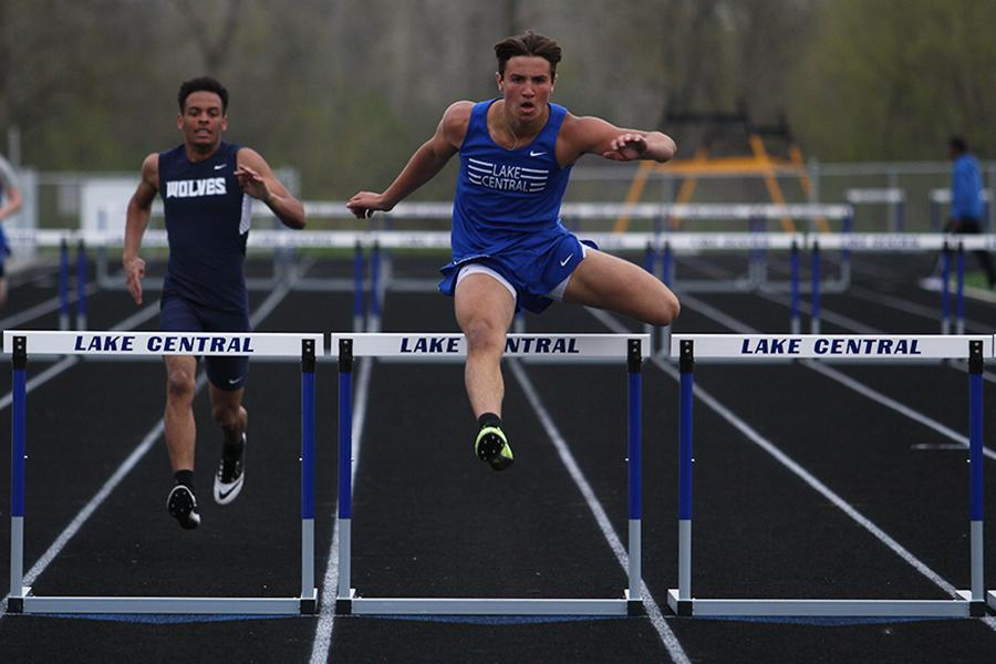 Nick+Lucas+%2811%29+jumps+over+a+hurdle+during+the+300-meter+hurdles+event.++Lucas+received+second+place+with+a+time+of+44.87+seconds.