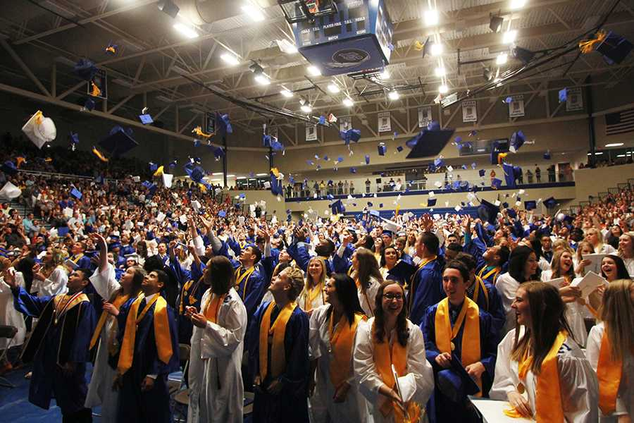 Caps are thrown in the air as the graduation ceremony concludes. Cheers filled the gymnasium as the students celebrated their success and entry to the next chapter of their lives.