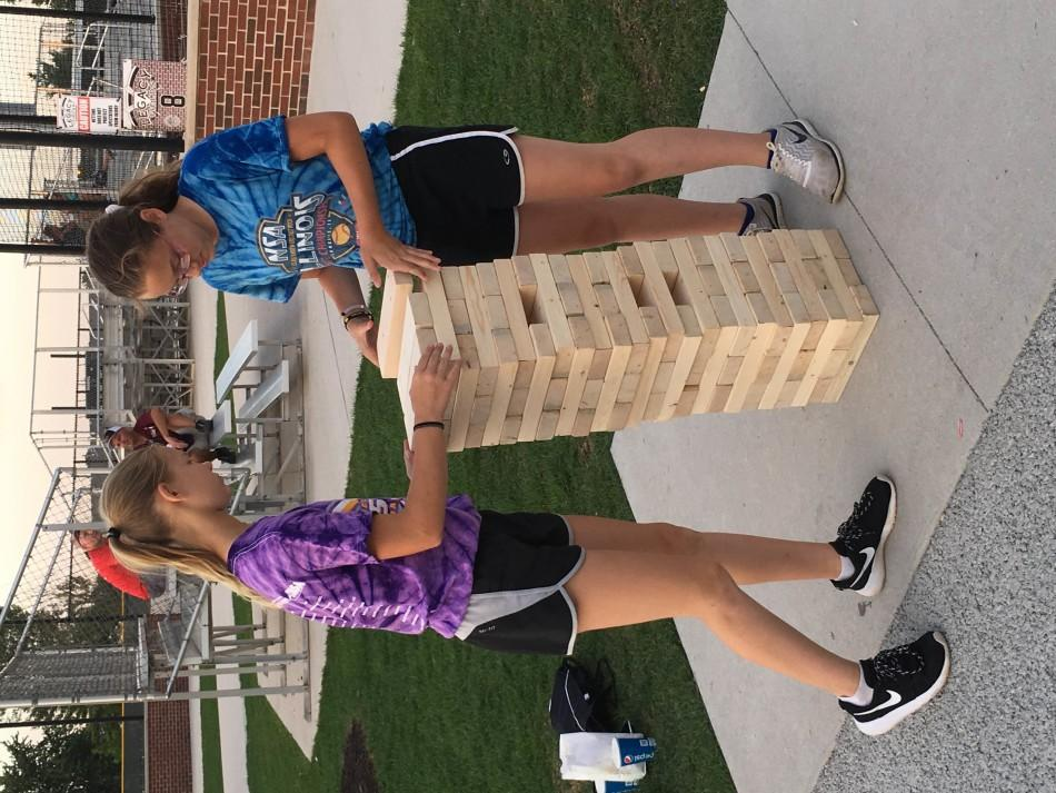 Two+girls+play+Jenga+together+during+the+block+party.+The+block+party+was+held+from+6%3A30-10+p.m.+