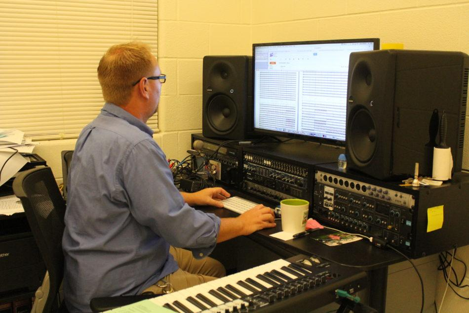 Mr. Nelson, arts, analyzes the band's music. Nelson is in charge of the marching band program.