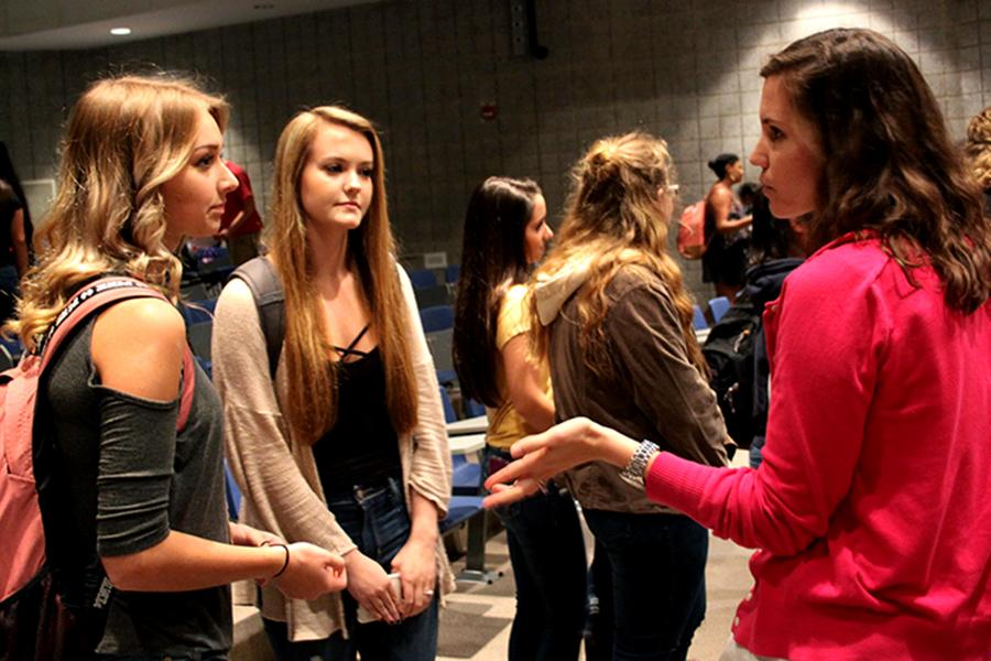 Mrs. Kelsey Becich answering students' questions.  Becich, the sponsor of the club, organized the first meeting.