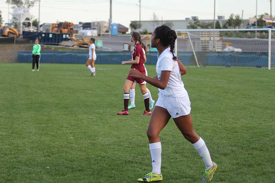 Bianca Matchain (10) runs along the sideline. Matchain yelled to her teammates to tell them that