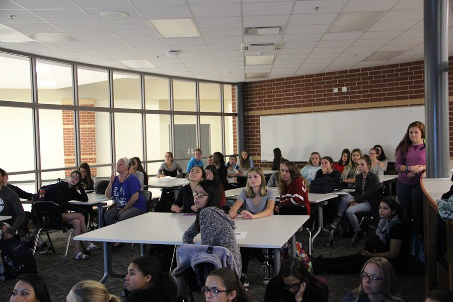 Students watch a video about Best Buddies in the library. The students were excited to learn more about this club.