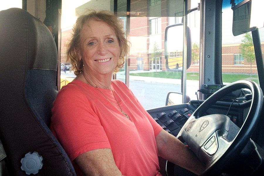 Mrs.Carolyn+Ready+smiles+and+waits+for+Mr.+Mcallister%2C+Assistant+Principal%2C+to+give+her+permission+to+leave+Lake+Central.+She+has+been+a+bus+driver+for+17+years.