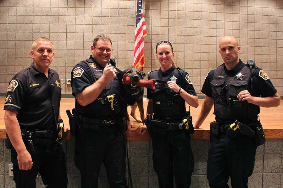 The officers from the St. John Police Station pose with the police dog. The program took place during the pathways to excellence class.