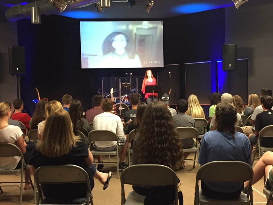 Phelps takes the stage for the first time at Suncrest Christian church to teach a message she wanted to share with many of her peers.  Phelps spoke about how she loved teaching and was very excited to pursue her teaching career in the future. Photo submitted by Haley Phelps