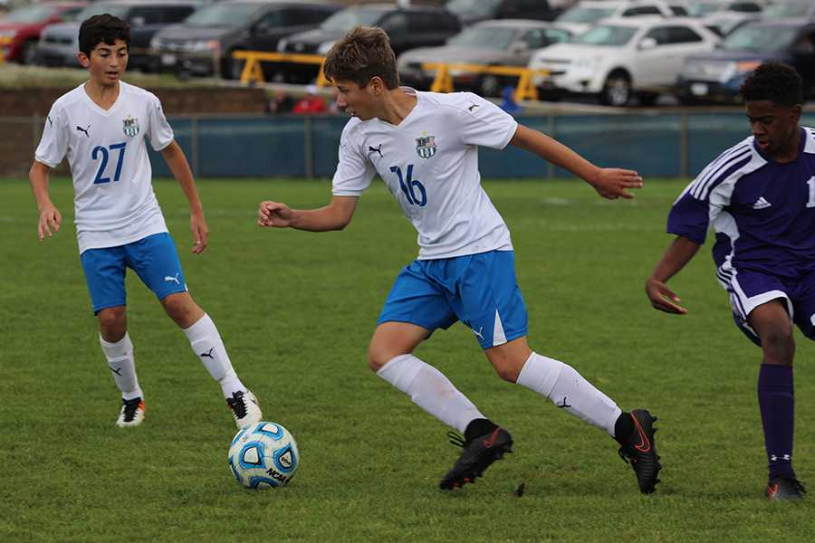 Adam+Santiago+%2810%29+races+to+keep+the+Merrillville+opponent+away+from+the+ball.+Santiago+was+making+his+way+towards+the+goal.