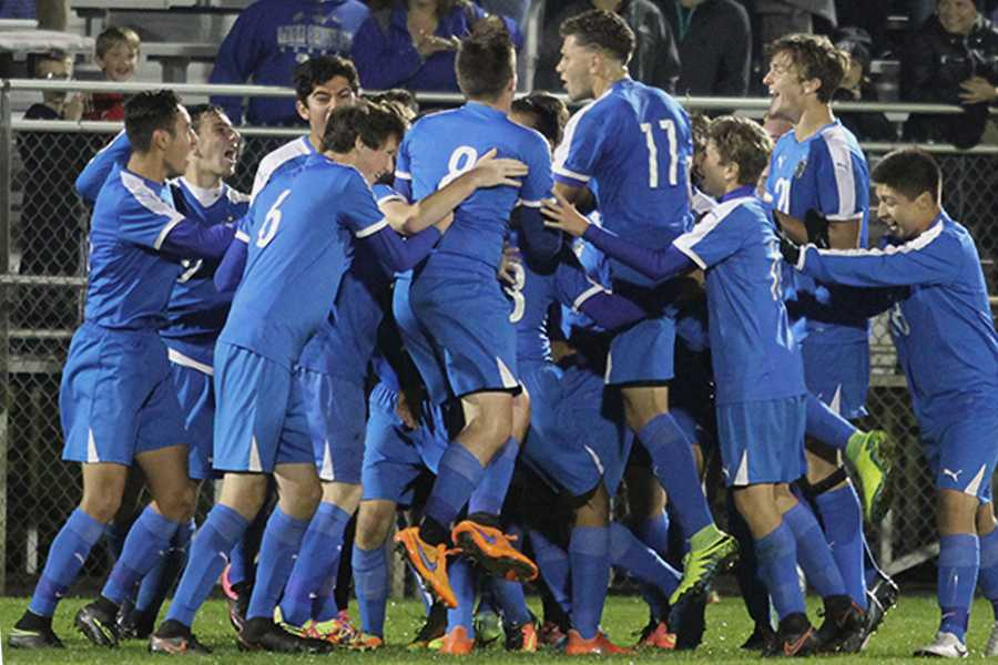 The boys varsity team celebrates on Saturday, Oct. 8, after a great victory over Highland 3-0. The team was ready to continue their journey to State with an intensity that filled the field.