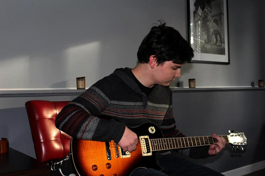 Bailey Corbett (10) strums his guitar. Corbett has been writing and sharing his music for almost four years.
