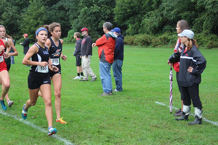 Sarah Hunsley (12) runs at the beginning of the race. Hunsley finished second in the varsity race with a time of 18:33.44.