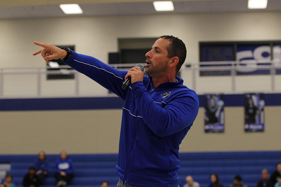 Head+coach+of+varsity+football%2C+Tony+Bartolomeo%2C+Science%2C+speaks+in+front+of+the+students+body+during+the+Homecoming+pep+rally.+Bartolomeo%2C+who+took+over+as+head+coach+on+Sept.+13%2C+coached+the+team+to+a+38-0+victory+later+that+day.%0A