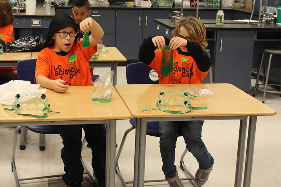 Two elementary school students finish their slime.They stretched, smashed and examined their new polymer.