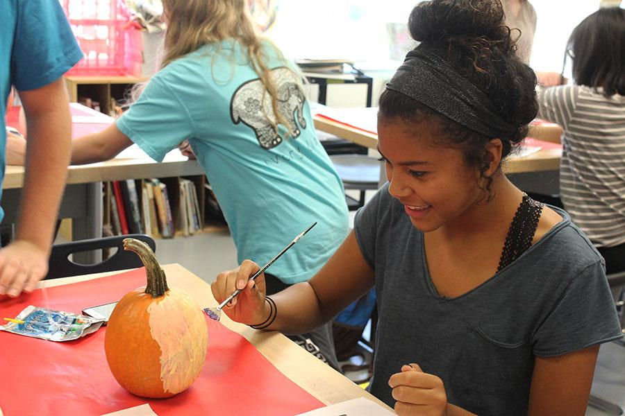 Bianca Matchain (10) starts to paint a purple cat on her pumpkin. She was pleased with the outcome of her pumpkin.