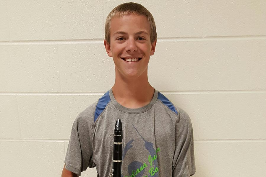 William Zollman (10) poses with his clarinet before marching practice. Zollman is a section leader in marching band, as well as a member of jazz band.