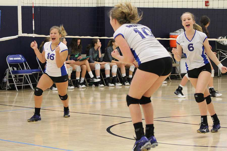 Madeline+Bailey+%289%29%2C+Kalli+Blankenship+%289%29+and+Madeline+Chiabai+%289%29+celebrate+after+scoring+a+point.+The+score+was+very+close+throughout+all+sets.
