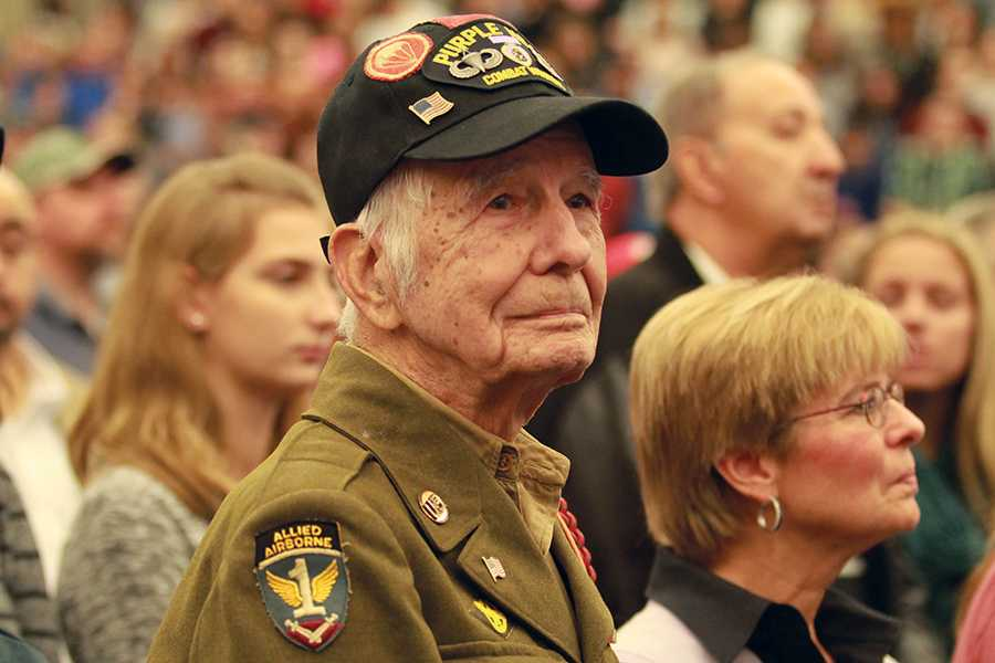 Mr. Harold Johnson, World War II Army veteran and paratrooper, watches the assembly with reverence. Johnson was specially called out and thanked for his service.