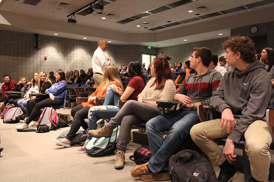 Students pay attention to club advisor, Mr. Kania.  Around 80 students attended the meeting.