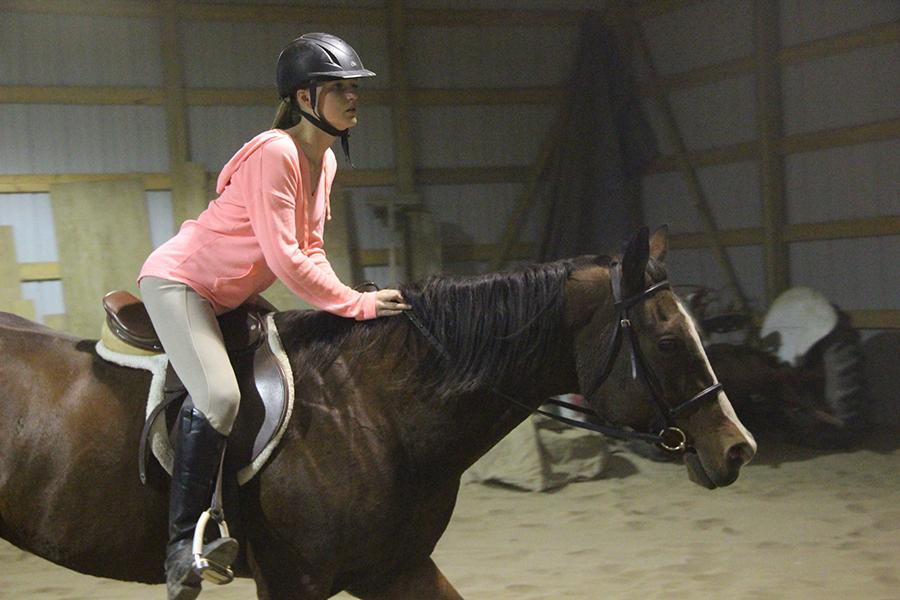 Alison+Phelps+%2810%29+is+practicing+her+posting+trot.+She+practiced+all+of+her+skills+with+her+horse+to+be+perfect+for+competition.%0A