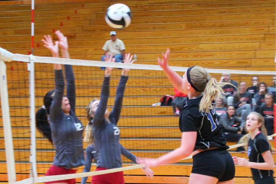 Nicole Milaszewski (12) jumps to spike the ball. Coach Tina Tinberg suggested that a better offense may have helped to turn the match around.