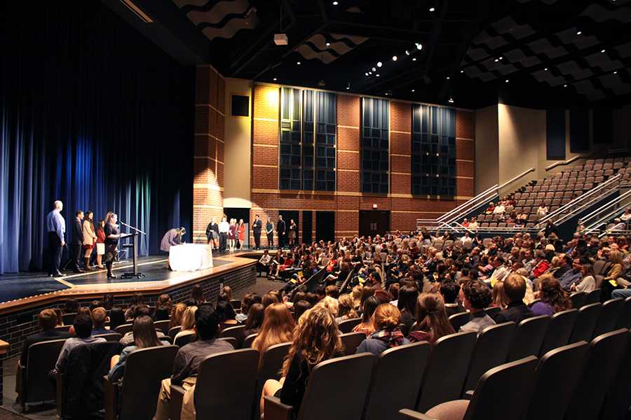 The auditorium is filled with students and parents. In total, 161 students were inducted into NHS.