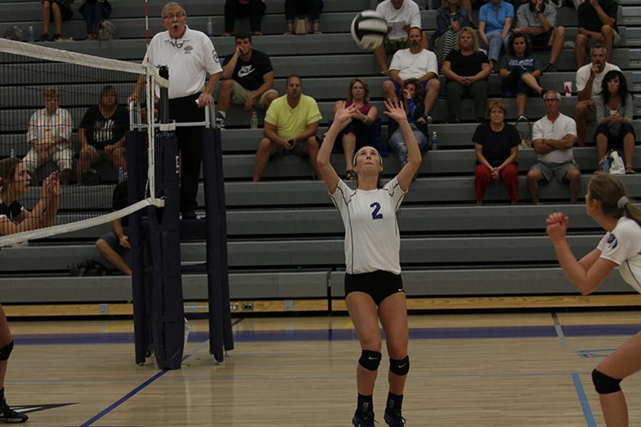 Mia DiNino (11) sets the ball up for one of her teammates. DiNino is one of setters for the varsity squad.