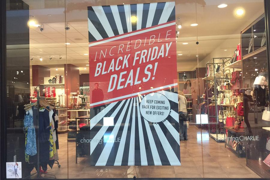 Charming Charlie's in Southlake Mall advertises for Black Friday. The mall has been one of the busiest places to shop on Black Friday and has made holiday hours to accommodate this.