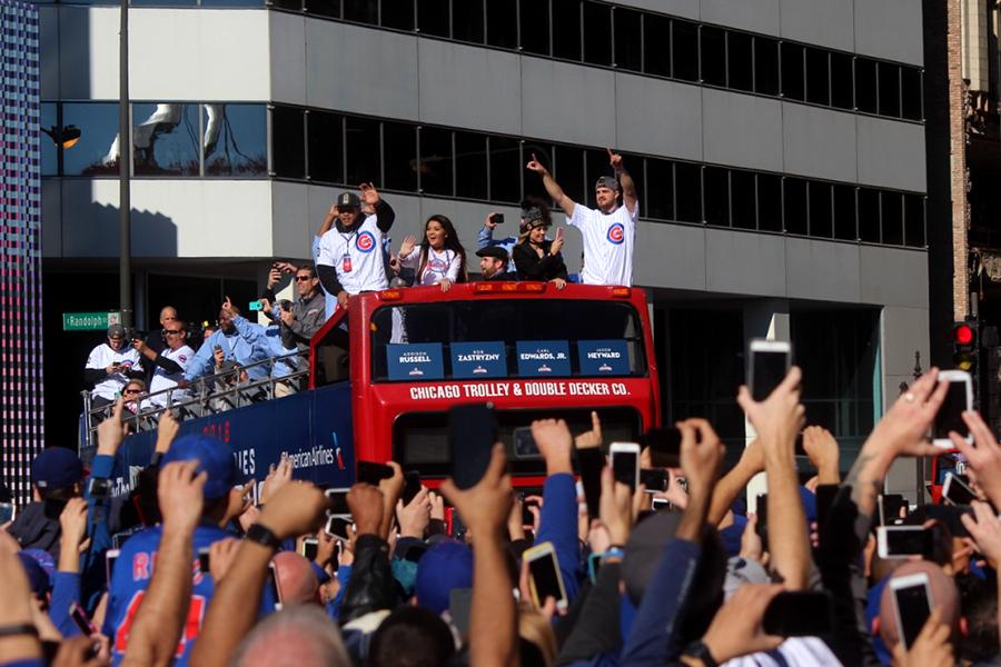 Cubs+players+cheer+on+with+the+fans+while+going+down+Lakeshore+Drive.+The+parade+consisted+of+five+million+cubs+fans.+Photo+by%3A+Jessica+Cook+%2811%29