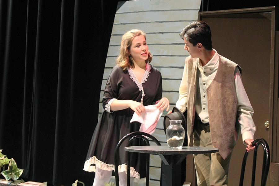 Katherine Morzy (10) and Benjamin Basem (11) converse on stage. Their characters were Maug, who worked at the hotel, and Mr. Morrison, who was representative of a younger Mr. Flannery.