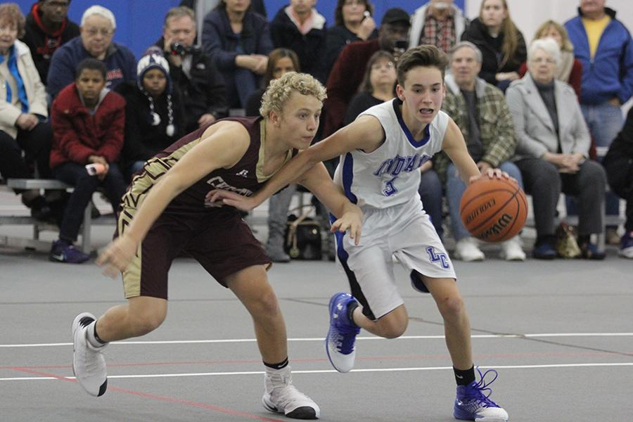 Nicholas Anderson (9) runs with the ball while a Chesterton player tries to steal it from him. Anderson was the freshmen boys basketball team captain.