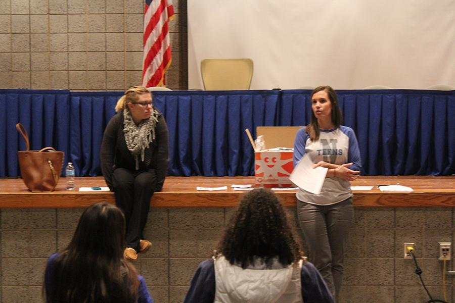 Mrs. Kelsey Becich, English, opens the N-Teens meeting on Tuesday, Nov. 22. They discussed this year's Winter Formal.