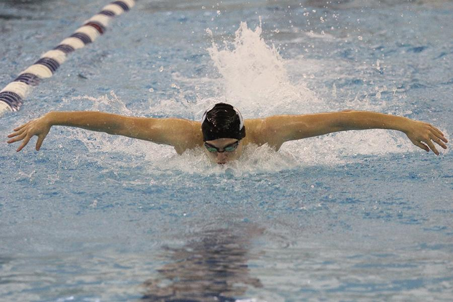 Gavin+Baisa+%2812%29+is+mid-stroke+in+his+100-meter+fly.++This+was+a+close+race+for+Baisa.++