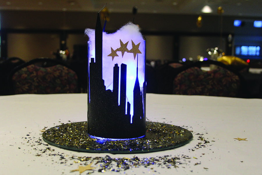 The+centerpiece+glows+with+an+outline+of+a+city+skyline.+Students+decided+make+the+theme+of+the+dance+%E2%80%9CCity+of+Lights%E2%80%9D.%0A