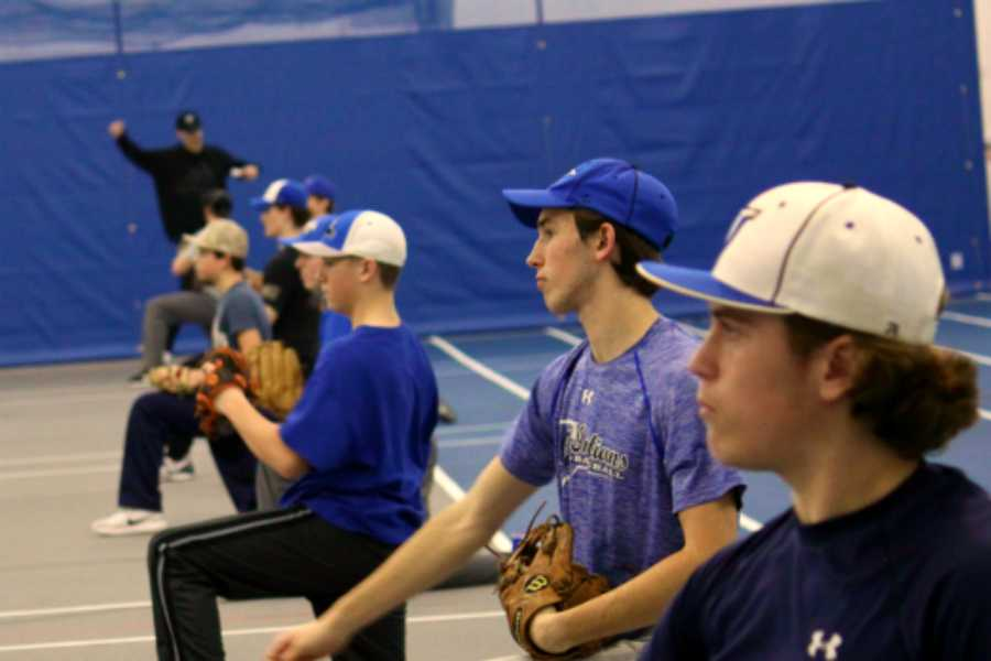 Boys do pitching and catching exercises with Coach Grant Weinmann. This year was Weinmann's first year as a volunteer pitching coach at Lake Central.