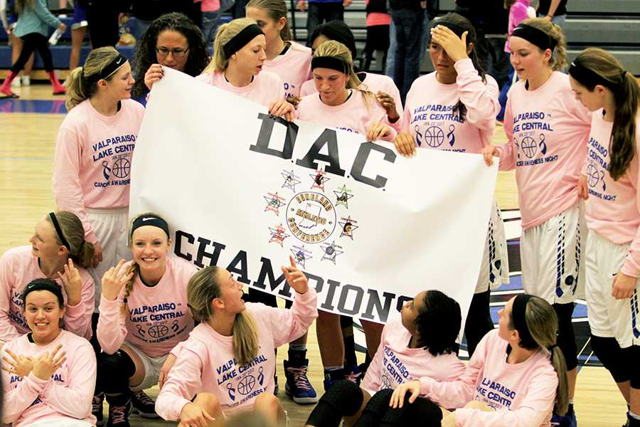The varsity girls basketball celebrates their victory after just winning the DAC. This was the girls third consecutive year winning the DAC.