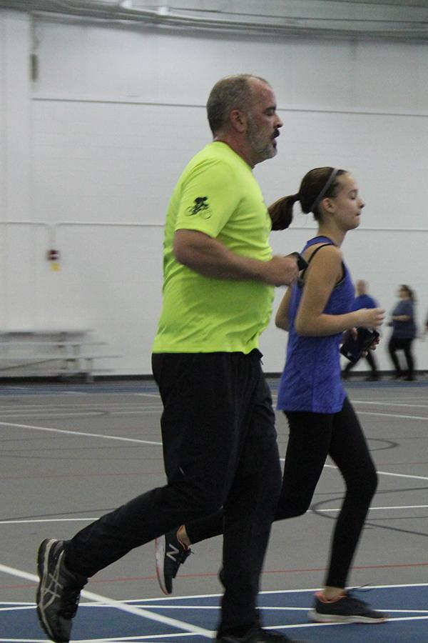 A+father+and+daughter+walk+their+way+through+the+Fieldhouse.+Guests+utilized+the+fieldhouse+from+6-8+p.m.%0A