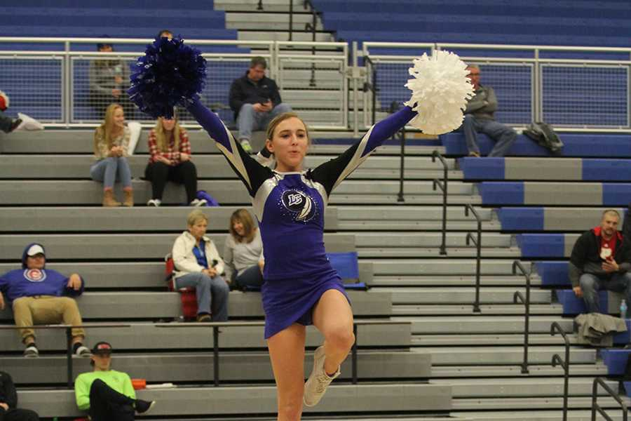 Molly Stokes (11) helps perform part of the cheerleaders Nationals routine during halftime. The girls will be going to Nationals in February.  Photo by: Karisa Candreva (10)
