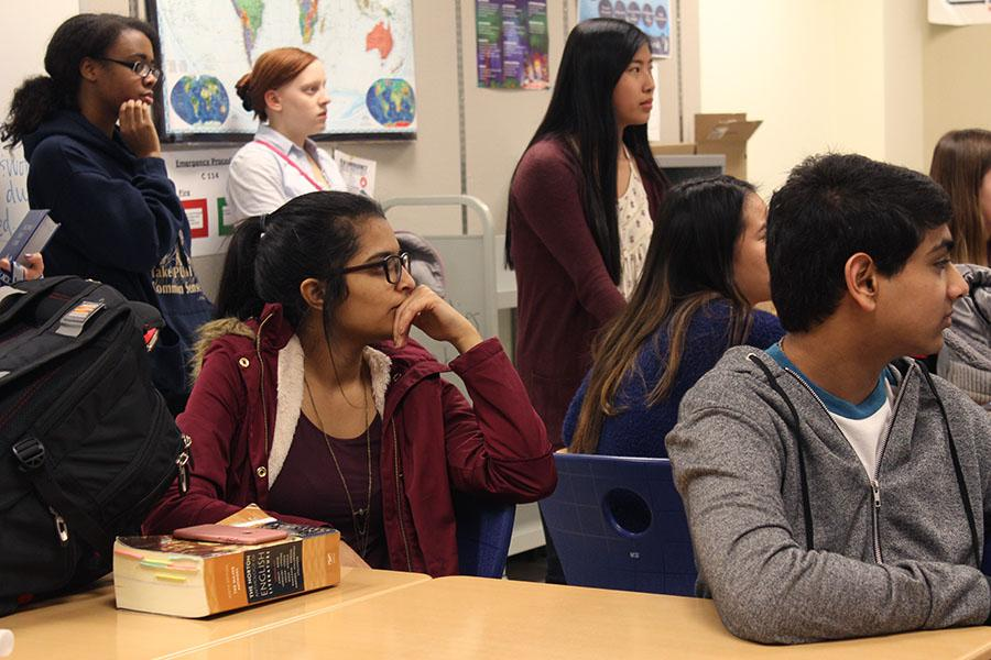 N-Teens members listen to Mrs. Becich, English, list the food options. Members chose three different hor d'oeuvres for formal.
