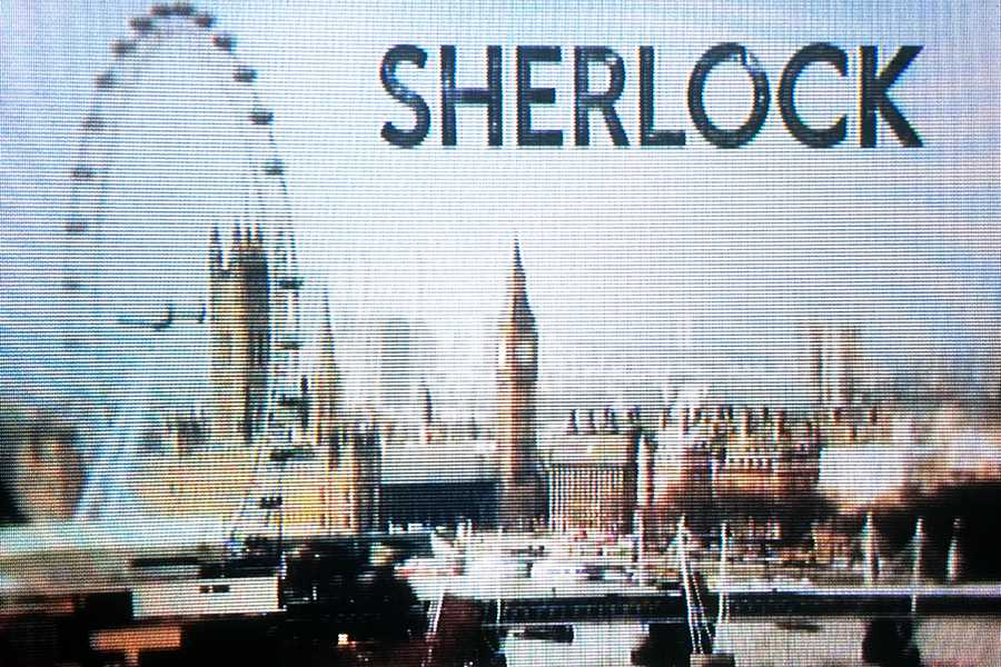 "The introduction screen for ""Sherlock"" appears. The show is now in its fourth season."