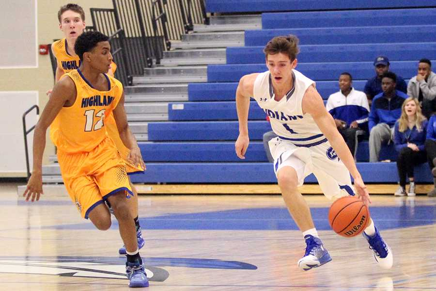 Derek+Hobbs+%289%29+dribbles+the+ball+down+the+court.+This+was+Hobbs%E2%80%99+first+year+on+varsity.+%0A