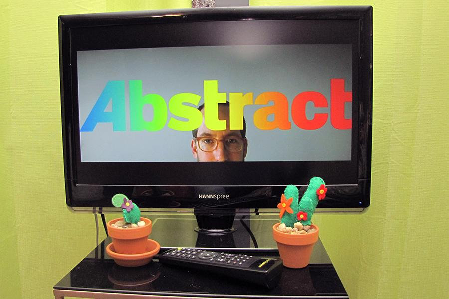 "The first episode's title sequence of ""Abstract: The Art of Design"" shows on a screen. This show was released on Netflix in February."